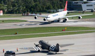 TurkishAirlines_A343_TC-JII_DakotaHeritage IncOwnerTrust_DC3_N473DC_ZRH160813_01